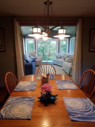 Harwich Cape Cod vacation rental - dining table fits 8+ seating, opens into  new sun room