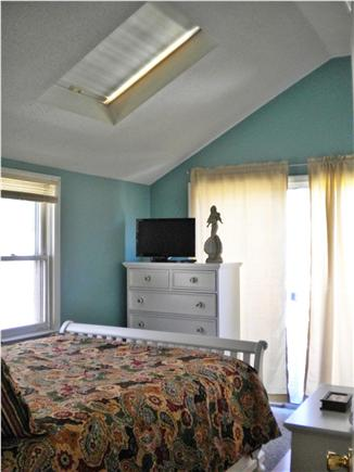 Dennis Port Cape Cod vacation rental - Bedroom with additional slider leading to backyard.