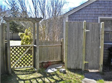 Dennis Port Cape Cod vacation rental - Outdoor shower and gate leading to driveway.