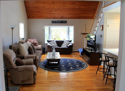 East Orleans Cape Cod vacation rental - Kitchen opens to Great Room with water views and flat screen tv