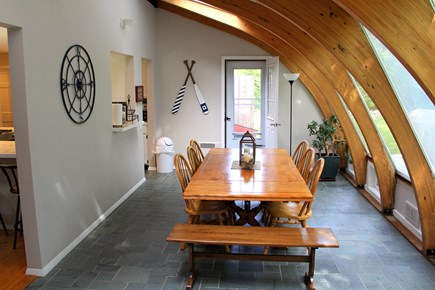 East Orleans Cape Cod vacation rental - Dining room in sun room with seating for 8+ full view of backyard