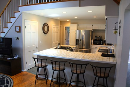 East Orleans Cape Cod vacation rental - Kitchen opens to Great Room and Sunroom with large dining table