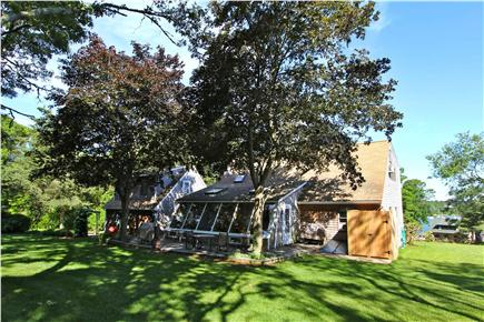 East Orleans Cape Cod vacation rental - Rear of house w deck, chiminea, outdoor shower, and dining for 8