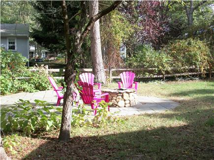 Long Pond, Harwich Cape Cod vacation rental - Slate corner patio with firepit - lots of sun all day long!