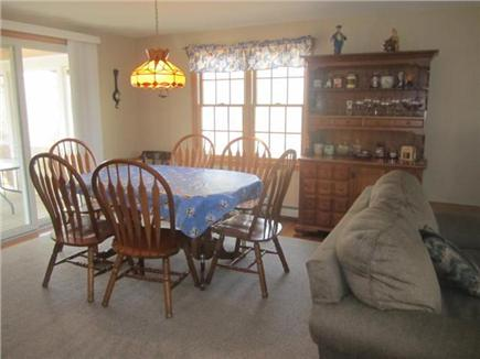 Harwich Cape Cod vacation rental - Dining area with sliders to screened sunroom