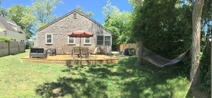 Dennisport Cape Cod vacation rental - View of the backyard, outdoor shower is to the left