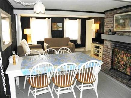 North Eastham Cape Cod vacation rental - Dining table (chairs for 8) and living room area with TV/DVD