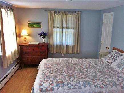 North Eastham Cape Cod vacation rental - Front bedroom with queen bed and writing desk (1st floor)