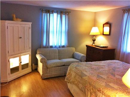 North Eastham Cape Cod vacation rental - Back bedroom with queen bed, love seat and TV cabinet (1st floor)