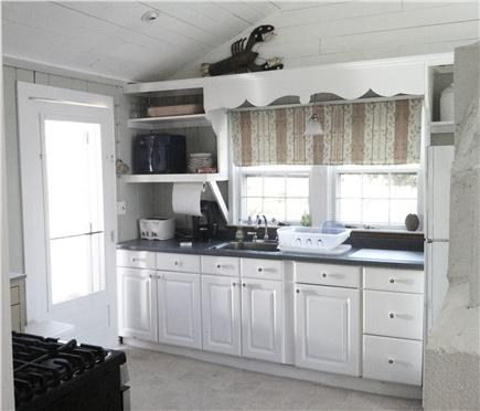 Chatham Cape Cod vacation rental - Kitchen with door to deck & now with dishwasher! (not pictured)