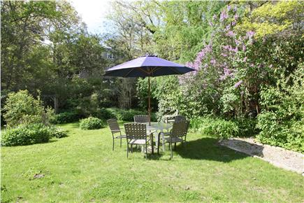 Brewster Cape Cod vacation rental - A section of  the back yard with outdoor eating area