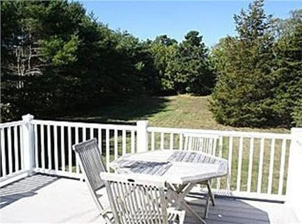 Brewster Cape Cod vacation rental - Deck, large yard, and new outdoor shower, plus firepit area