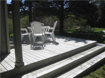 Brewster Cape Cod vacation rental - Backyard and deck with outdoor shower & fire pit