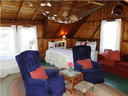 Falmouth  Cape Cod vacation rental - Living room area facing queen bed