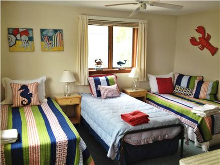 Mashpee Cape Cod vacation rental - Upstairs bedroom includes a trundle bed and twin bed.