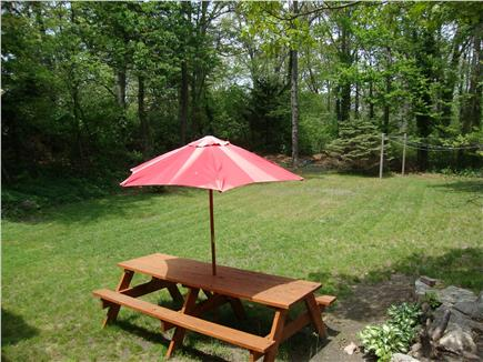 Brewster Cape Cod vacation rental - Backyard with volley ball net and horse shoe