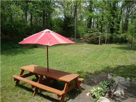Brewster Cape Cod vacation rental - Backyard with volleyball net and horse shoe