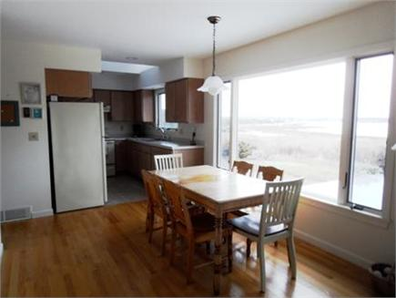 Wellfleet Cape Cod vacation rental - Dining table with view out picture window