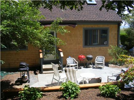 Chatham Cape Cod vacation rental - Back of home with patio and awning