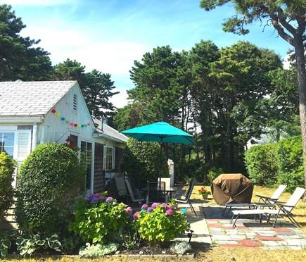 West Harwich Cape Cod vacation rental - Peaceful, private patio area with gas grill and water view.
