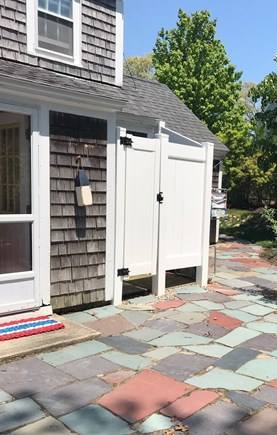 Harwichport Cape Cod vacation rental - Enjoy the patio with outdoor shower, firepit and gas grill.
