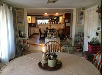 Barnstable Cape Cod vacation rental - Dining Room with slider to front deck, one step up to kitchen