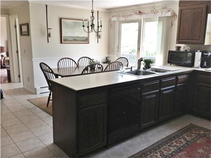 Dennis Village Cape Cod vacation rental - Large eat in kitchen ,seats eight, leading to deck