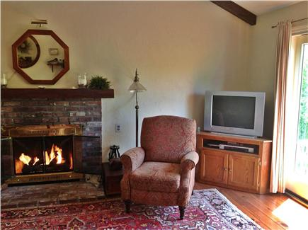 Dennis Village Cape Cod vacation rental - Family Room showing fireplace and doors leading to the deck