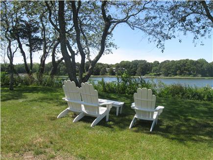 East Orleans Cape Cod vacation rental - Adirondack chairs overlooking view and Fire Pit