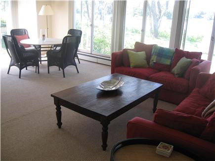 East Orleans Cape Cod vacation rental - Living room has large windows with water views and sleeper sofa.