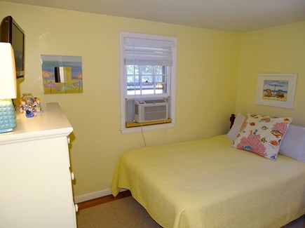 West Yarmouth Cape Cod vacation rental - Yellow bedroom with full bed, TV, and A/C