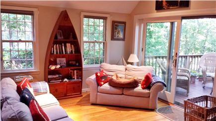 Eastham Cape Cod vacation rental - Living room showing the sliding door onto the large deck.