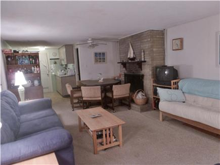 West Dennis Cape Cod vacation rental - Living room and dining area, with kitchen in background