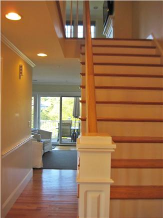 Chatham Cape Cod vacation rental - Stairway to second floor and hallway to Kitchen, Deck & Basement