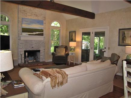East Sandwich Cape Cod vacation rental - Living room with fireplace and back yard view