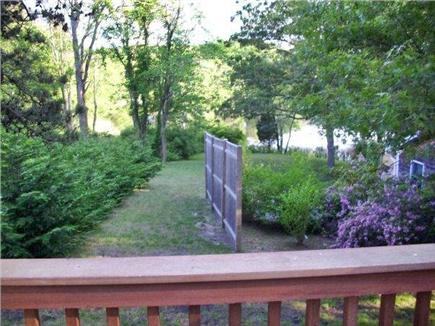 Orleans Cape Cod vacation rental - View of walkway to pond from the back deck