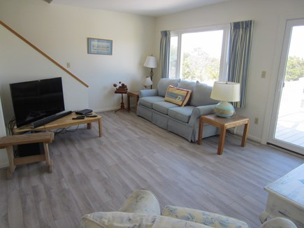 East Dennis Cape Cod vacation rental - Alternate view of living room with stairs to 3rd floor