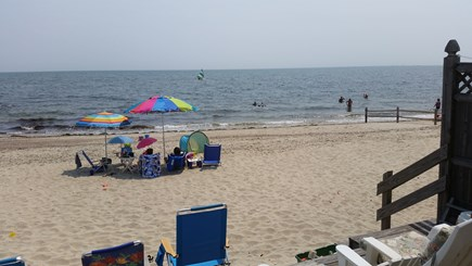 Dennis Port Cape Cod vacation rental - View from deck. Vacationers enjoying private beach.
