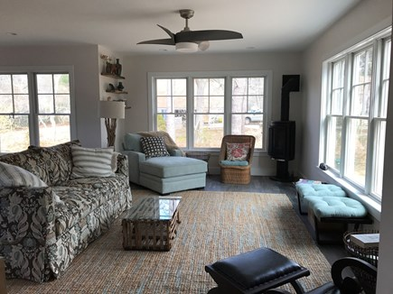 Eastham Cape Cod vacation rental - Living room w/ fireplace, surrounded by windows