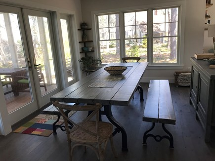 Eastham Cape Cod vacation rental - DR table made by local artisan w salvaged wood & cast iron anchor