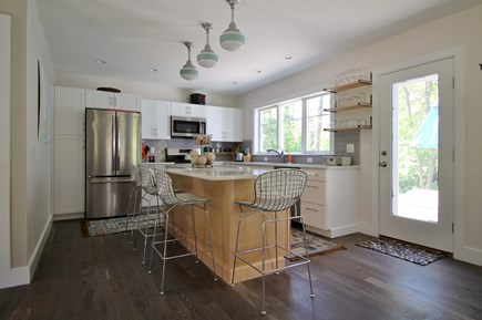 Eastham Cape Cod vacation rental - Eat-in kitchen looks out onto deck and yard