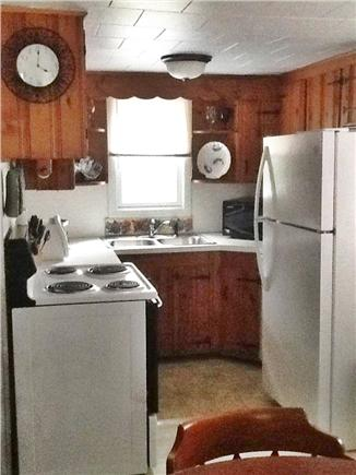 South Yarmouth Cape Cod vacation rental - Knotty pine kitchen with dishwasher