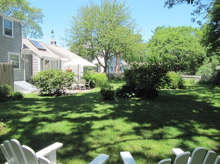 Osterville Osterville vacation rental - The backyard with a lovely garden, a swingset and a hammock.