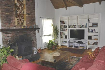 North Truro Cape Cod vacation rental - Sitting area with TV and diverse library