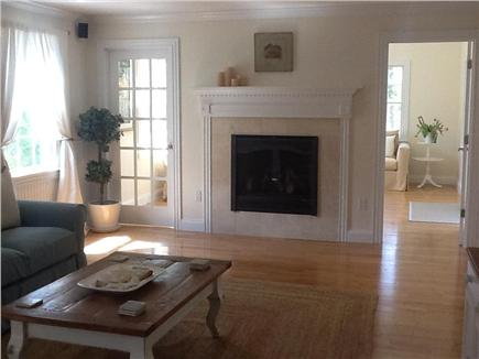 Brewster, Chatham/Orleans Cape Cod vacation rental - The Living Room fireplace and the Sun Room beyond