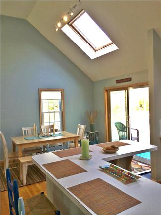 Eastham Cape Cod vacation rental - Well equipped kitchen with seating at island and dining area.