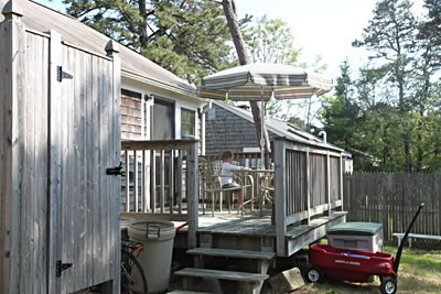 Dennisport Cape Cod vacation rental - Back deck with large yard and outside shower
