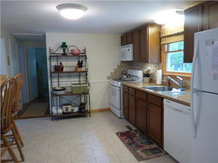 Yarmouthport Cape Cod vacation rental - Kitchen open to LR with open stools
