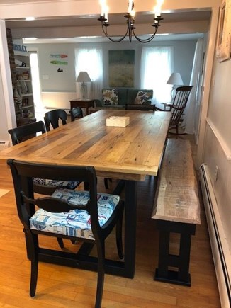 North Eastham Cape Cod vacation rental - Eat in kitchen with large farm table looking into the living room