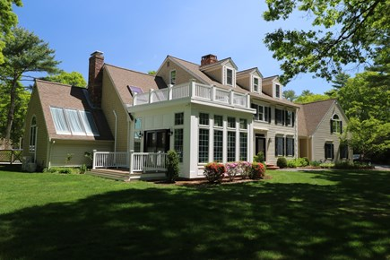 Sandwich, Cape Cod Cape Cod vacation rental - Front of house showing new sunroom and side deck.